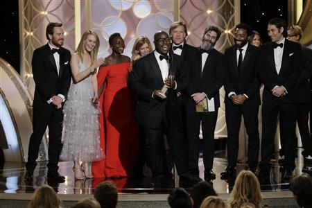 """British director Steve McQueen celebrates after winning Best Motion Picture, Drama, for """"12 Years a Slave"""" at the 71st annual Golden Globe Awards in Beverly Hills, California January 12, 2014. REUTERS/Paul Drinkwater/NBCUniversal/Handout"""