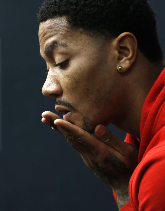 Chicago Bulls' Derrick Rose ponders a question during an NBA basketball news conference about his injured knee at the United Center Thursday, Dec. 5, 2013, in Chicago. (AP Photo/Charles Rex Arbogast)