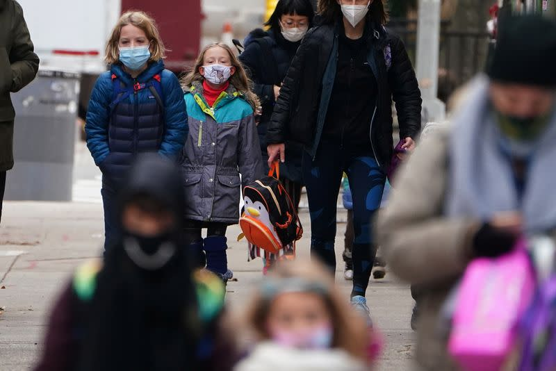 Students arrive at PS 361 on the first day of a return to class during the coronavirus disease (COVID-19) pandemic in the Manhattan borough of New York City