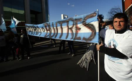 Supporters of Argentina's government hold a sign in Buenos Aires