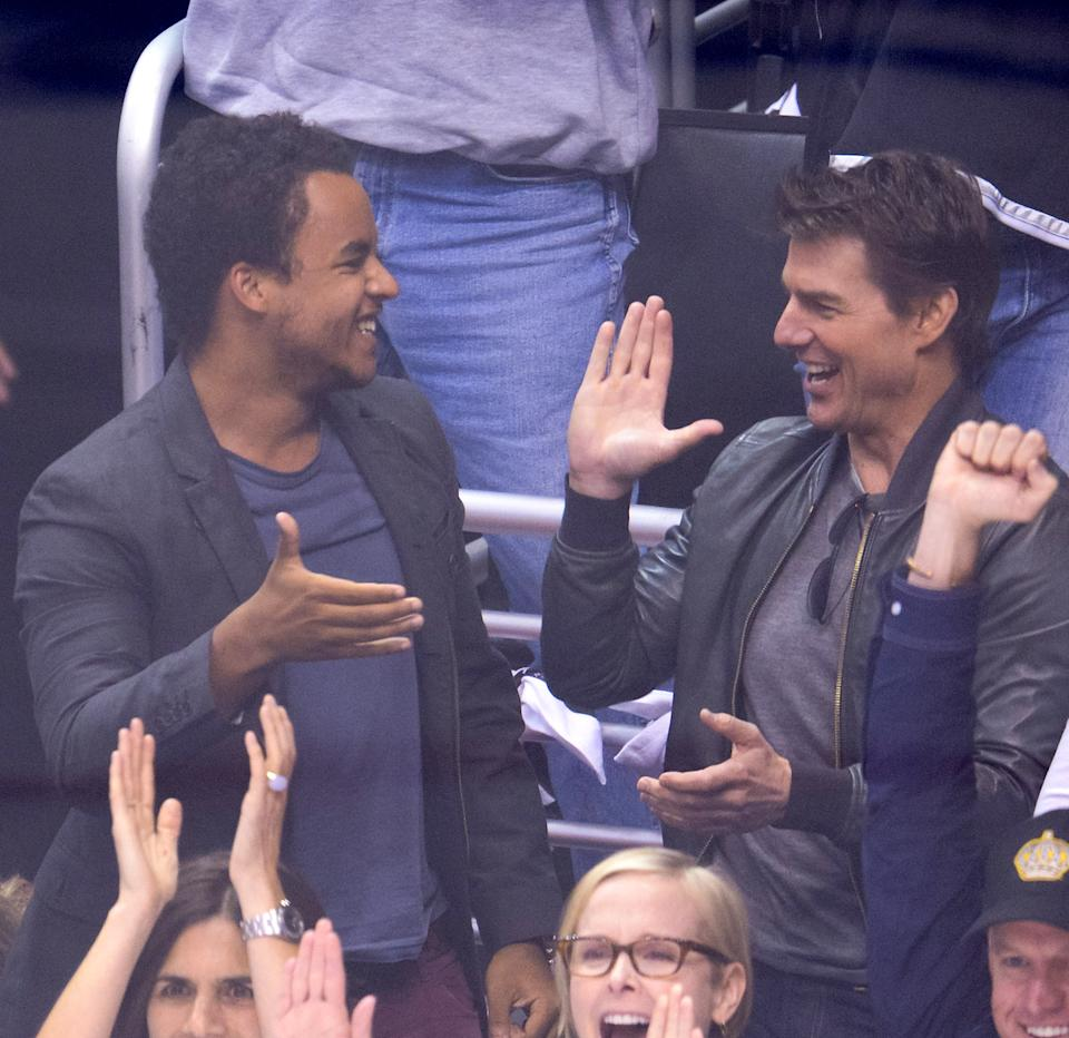 LOS ANGELES, CA - JUNE 04:  Connor Cruise (L) and Tom Cruise attend an NHL playoff game between the Chicago Blackhawks and the Los Angeles Kings at Staples Center on June 4, 2013 in Los Angeles, California.  (Photo by Noel Vasquez/Getty Images)