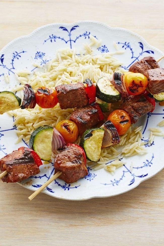 """<p>Yes, they're delicious and colorful, but those aren't the only reasons you'll love these kebabs: You can also make them in advance!</p><p><strong><a href=""""https://www.thepioneerwoman.com/food-cooking/recipes/a32209934/beef-vegetable-kebabs/"""" rel=""""nofollow noopener"""" target=""""_blank"""" data-ylk=""""slk:Get the recipe"""" class=""""link rapid-noclick-resp"""">Get the recipe</a>.</strong></p><p><strong><a class=""""link rapid-noclick-resp"""" href=""""https://go.redirectingat.com?id=74968X1596630&url=https%3A%2F%2Fwww.walmart.com%2Fbrowse%2Fhome%2Fserveware%2Fthe-pioneer-woman%2F4044_623679_639999_2347672&sref=https%3A%2F%2Fwww.thepioneerwoman.com%2Ffood-cooking%2Fmeals-menus%2Fg32188535%2Fbest-grilling-recipes%2F"""" rel=""""nofollow noopener"""" target=""""_blank"""" data-ylk=""""slk:SHOP PLATTERS"""">SHOP PLATTERS</a></strong></p>"""