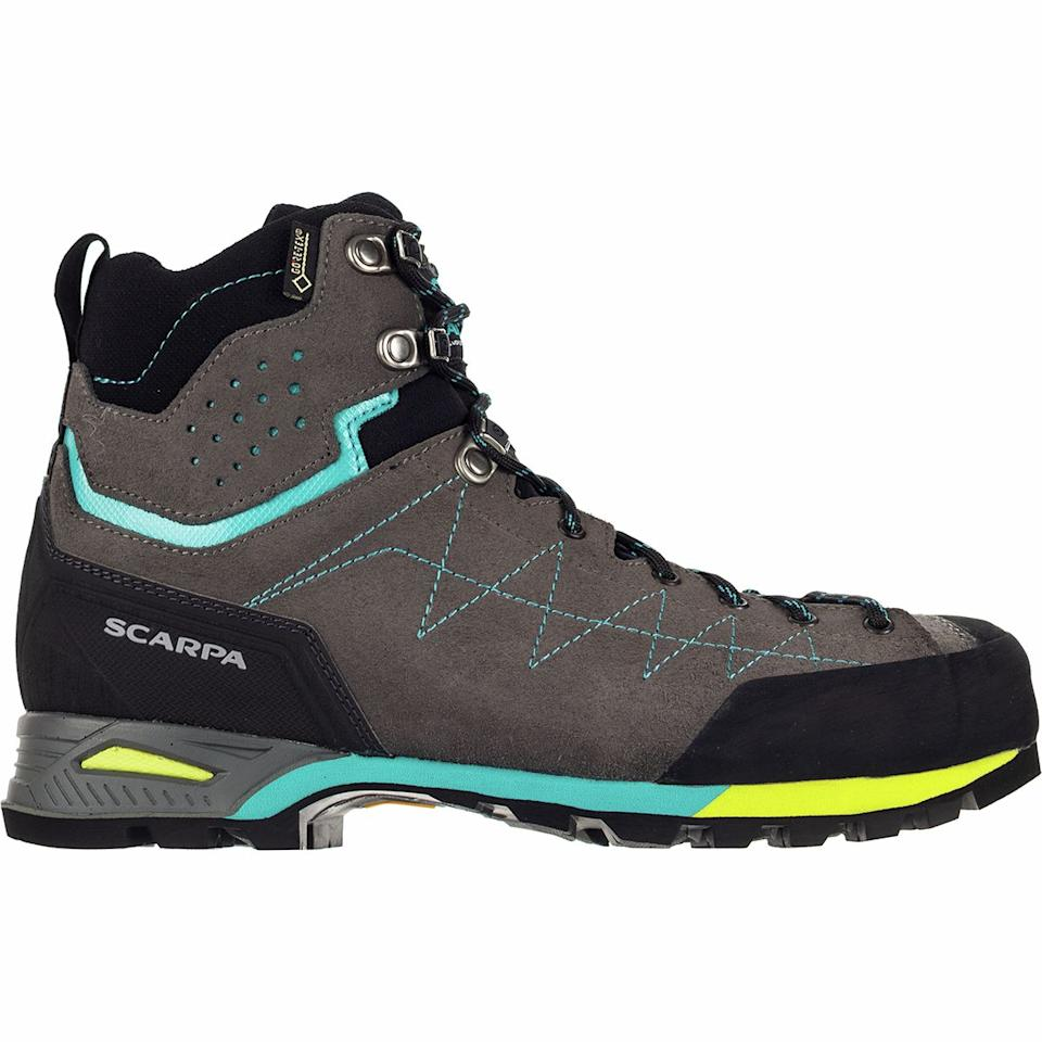 "<h2>Scarpa Zodiac Plus GTX Backpacking Boot</h2><br><strong>The Most Structured Boot</strong><br>We'd normally never recommend a shoe that reviewers find to be rigid, but when traversing mountainous terrain, a slightly stiff exterior can be a welcome layer of protection against unpredictable, rugged surfaces. More than one Backcountry reviewer went into rapturous detail about the boots' tough, summit-ready properties.<br><br><strong>The Hype: </strong>4.5 out of 5 stars; 5 reviews on <a href=""https://www.backcountry.com/scarpa-zodiac-plus-gtx-backpacking-boot-womens"" rel=""nofollow noopener"" target=""_blank"" data-ylk=""slk:Backcountry.com"" class=""link rapid-noclick-resp"">Backcountry.com</a><br><br><strong>What They're Saying: </strong>""I needed a solid mid hiker for high-mountain backpacking and off-trail hiking in general. I prefer leather uppers for longevity and maintenance. The Zodiac fits absolutely perfectly and is so comfortable right out of the box. The stiffness is also perfect for what I need it, rough terrain, but I don't feel they are overly stiff like mountaineering boots. I have a slightly wider foot (not enough for a wide, though) and the slightly wider toe-box is great. I have worn it on some varied, muddy, rough terrain and absolutely love my purchase! This is BY FAR the best and most comfortable hiking boot I have ever owned, and I've owned a few. The traction and stability are amazing! I truly love this boot!"" <em>— Liv, </em><a href=""https://www.backcountry.com/scarpa-zodiac-plus-gtx-backpacking-boot-womens"" rel=""nofollow noopener"" target=""_blank"" data-ylk=""slk:Backcountry.com"" class=""link rapid-noclick-resp""><em>Backcountry.com</em></a><em> reviewer</em><br><br><strong>Scarpa</strong> Zodiac Plus GTX Backpacking Boot, $, available at <a href=""https://go.skimresources.com/?id=30283X879131&url=https%3A%2F%2Fwww.backcountry.com%2Fscarpa-zodiac-plus-gtx-backpacking-boot-womens"" rel=""nofollow noopener"" target=""_blank"" data-ylk=""slk:Backcountry"" class=""link rapid-noclick-resp"">Backcountry</a>"