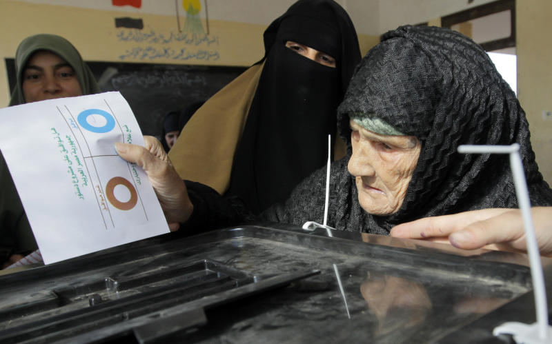Amnah Sayyed Moussa, 85, casts her vote for the second round of a referendum on a disputed constitution drafted by Islamist supporters of President Mohammed Morsi in Giza, Egypt, Saturday, Dec. 22, 2012. (AP Photo/Amr Nabil)