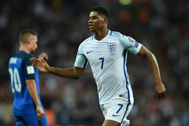 England's striker Marcus Rashford celebrates scoring England's second goal during the World Cup 2018 qualification football match against Slovakia at Wembley Stadium in London on September 4, 2017