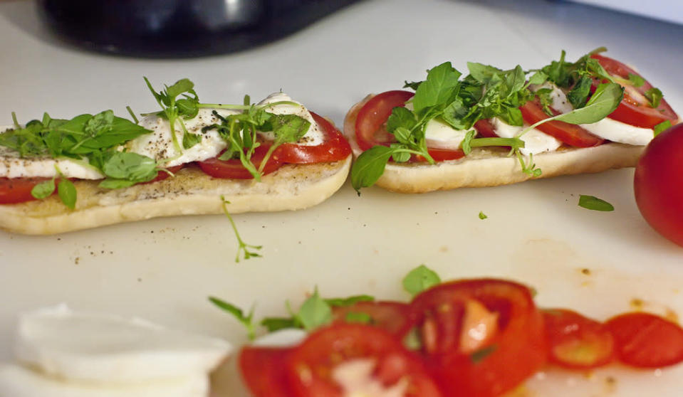 <p><b>Mozzarella & Tomato Sandwich with Microgreens</b><br></p><p>Adding microgreens - the toast of the gourmet world to sandwiches is a fabulous way of enjoying their multiple benefits & adding texture to our regular chow. Make a sandwich with some fresh mozzarella cheese, ripe tomato slices & add salami if you prefer. Douse a handful of microgreens (spinach, mustard or arugula) in lemon juice & olive oil, place on top of this open-faced sandwich & enjoy the fresh flavors.</p>