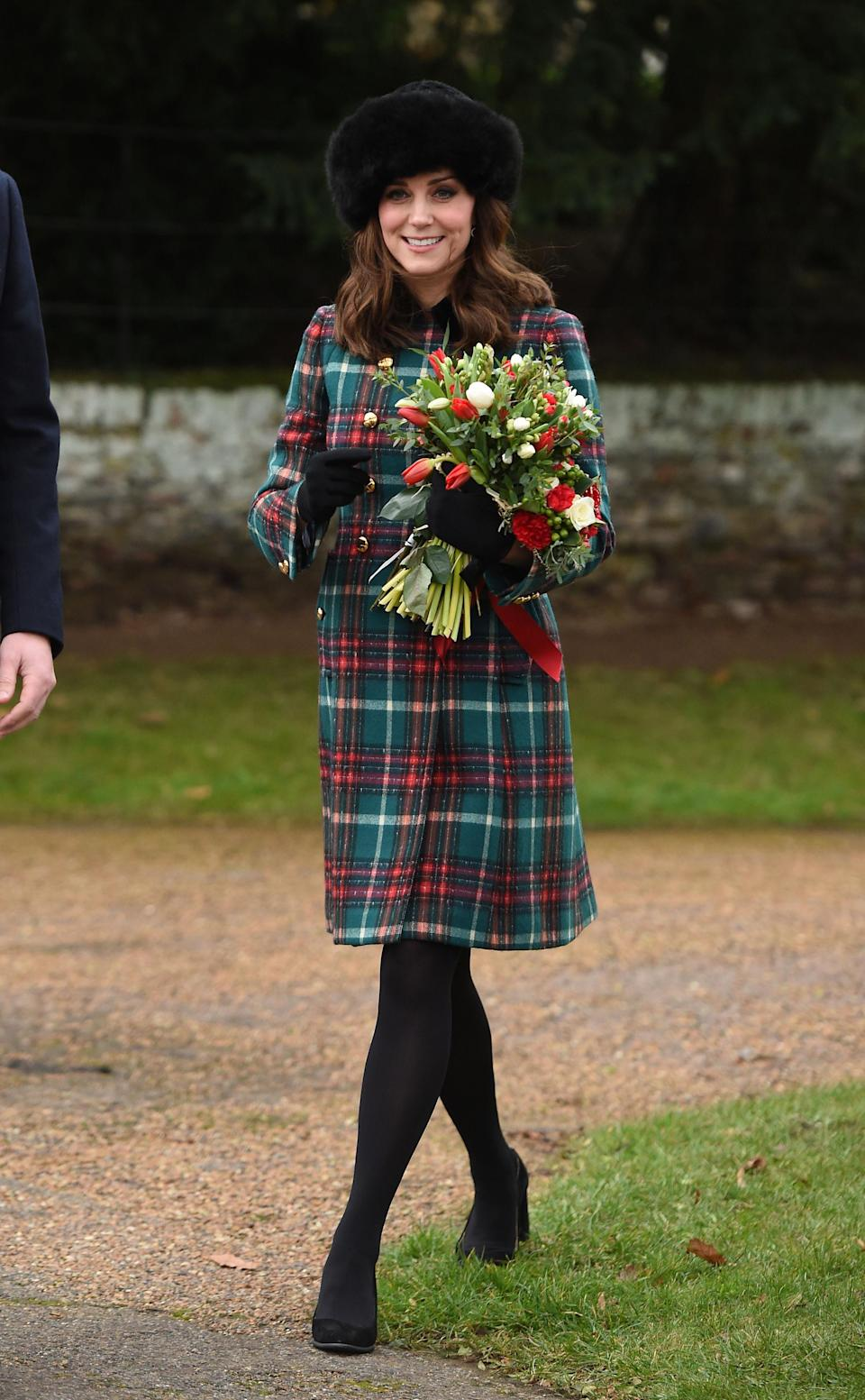 <p>The Duchess covered up her baby bump once again on Christmas Day, donning a £1859 tartan coat by Miu Miu. She paired the festive look with a Mulberry Bayswater clutch, black suede Tod's heels and a furry hat by Lacorine. <i>[Photo: Getty]</i> </p>