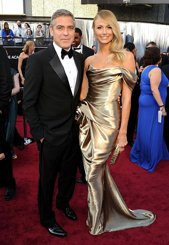 George Clooney and Stacy Keibler arrive at the 84th Annual Academy Awards in Hollywood, CA.