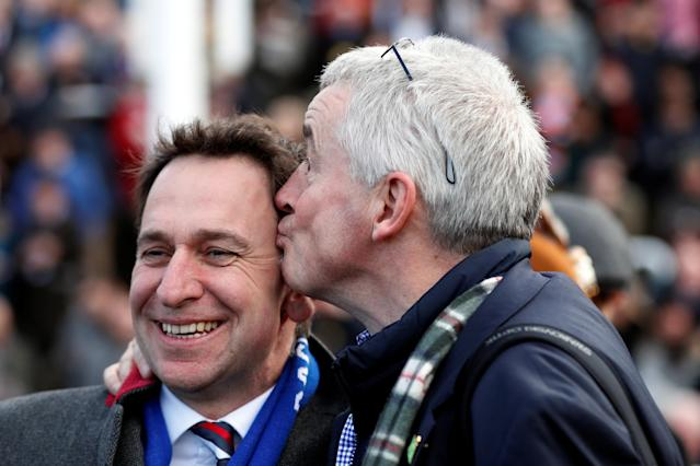 Horse Racing - Cheltenham Festival - Cheltenham Racecourse, Cheltenham, Britain - March 15, 2018 Ryanair Chief Executive Michael O'Leary and trainer Henry De Bromhead celebrate after winning the 14:50 Ryanair Chase Action Images via Reuters/Matthew Childs
