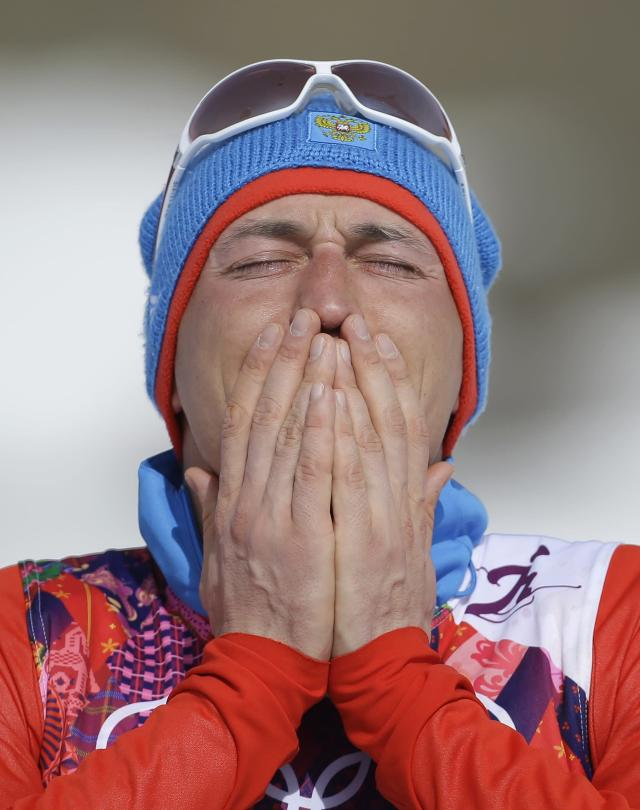 Russia's gold medal winner Alexander Legkov reacts during the flower ceremony of the men's 50K cross-country race at the 2014 Winter Olympics, Sunday, Feb. 23, 2014, in Krasnaya Polyana, Russia. (AP Photo/Gregorio Borgia)