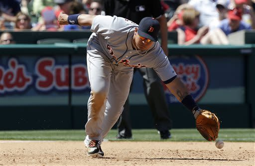 Detroit Tigers third baseman Miguel Cabrera can't get a glove on a base hit by Los Angeles Angels' Brendan Harris during the sixth inning of an MLB American League baseball game in Anaheim, Calif., Sunday, April 21, 2013. (AP Photo/Chris Carlson)