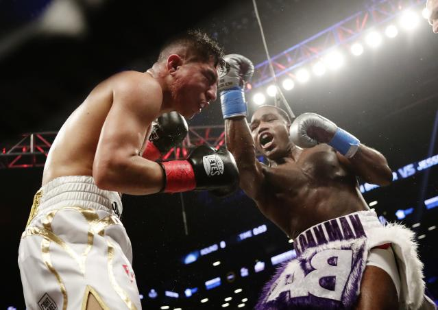 Adrien Broner, right, punches Jessie Vargas during the eighth round of a welterweight boxing match Saturday, April 21, 2018, in New York. (AP Photo/Frank Franklin II)