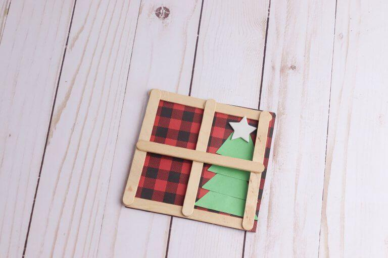 "<p>Popsicle sticks frame patterned scrapbook paper in this craft that evokes the look of a cozy Christmas scene inside a warm home. A green construction paper Christmas tree finishes the look.</p><p><em><a href=""https://littlebinsforlittlehands.com/popsicle-stick-craft-window-for-christmas/"" rel=""nofollow noopener"" target=""_blank"" data-ylk=""slk:Get the tutorial at Little Bins for Little Hands»"" class=""link rapid-noclick-resp"">Get the tutorial at Little Bins for Little Hands»</a></em><br></p>"