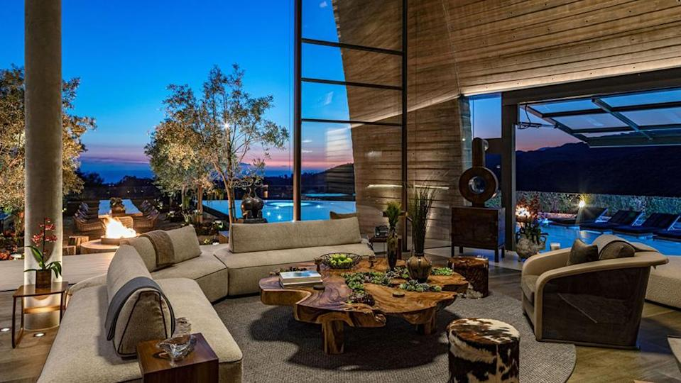 The indoor-outdoor design of the home allows guests to view the pool and horizon from the interior. - Credit: Simon Berlyn
