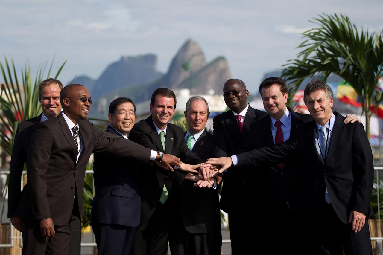<p>               ** CORRECTS FIRST NAME OF SAO PAULO MAYOR ** Mayors from left to right, Ecktar Wuerzner of Heildelberg, Franklyn Tau of Johannesburg, Won Soon Park of Seoul, Eduardo Paes of Rio de Janeiro, Michael Bloomberg of New York, Babatunde Fashola of Lagos,  Eduardo Kassab of Sao Paulo and Eduardo Macri of Buenos Aires pose for a photo during the Rio+C40: Megacity Mayors Taking Action on Climate Change, a parallel meeting to the UN Conference on Sustainable Development, or Rio+20, in Rio de Janeiro, Brazil, Tuesday, June 19, 2012. While squabbling between rich and poor countries threatens to derail the Earth summit, the world's mayors say they can't afford the luxury of endless, fruitless negotiations and are already taking real action to stave off environmental  disaster and preserve natural resources for future generations. (AP Photo/Felipe Dana)