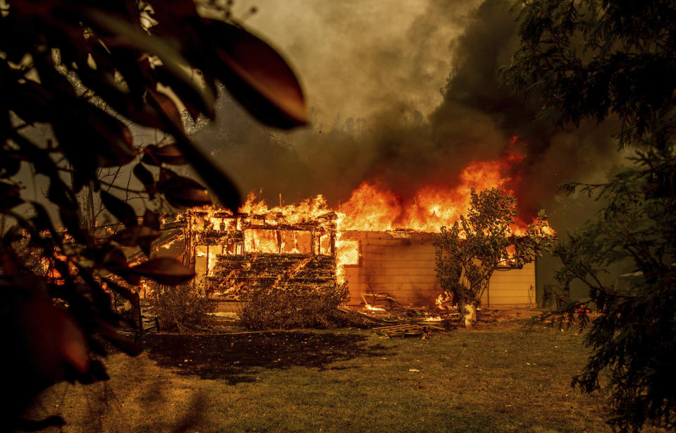 FILE - In this Sept. 23, 2021, file photo, flames consume a house near Old Oregon Trail as the Fawn Fire burns north of Redding in Shasta County, Calif. U.S. officials have approved a long-lasting fire retardant that could significantly aid in fighting increasingly destructive wildfires. The U.S. Forest Service on Tuesday, Oct. 5, 2021, approved Perimeter Solutions' fire retardant that's intended to be used as a preventative measure and can last for months. (AP Photo/Ethan Swope, File)