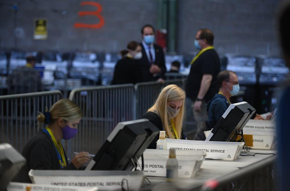 """<span class=""""caption"""">Election officials counting ballots at the Allegheny County elections warehouse Friday in Pittsburgh. </span> <span class=""""attribution""""><a class=""""link rapid-noclick-resp"""" href=""""https://www.gettyimages.com/detail/news-photo/election-officials-proceed-with-the-counting-of-ballots-at-news-photo/1229491374?adppopup=true"""" rel=""""nofollow noopener"""" target=""""_blank"""" data-ylk=""""slk:Jeff Swensen/Getty Images"""">Jeff Swensen/Getty Images</a></span>"""