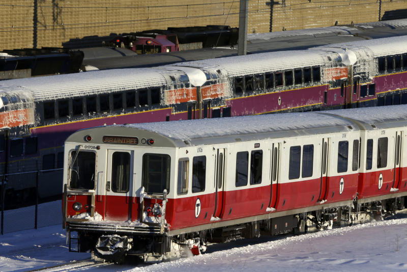 Massachusetts Bay Transportation Authority commuter trains wait to start running again early Sunday, Feb. 10, 2013 in Boston. The MBTA hopes to have commuter train service fully restored for the Monday morning rush hour. (AP Photo/Gene J. Puskar)