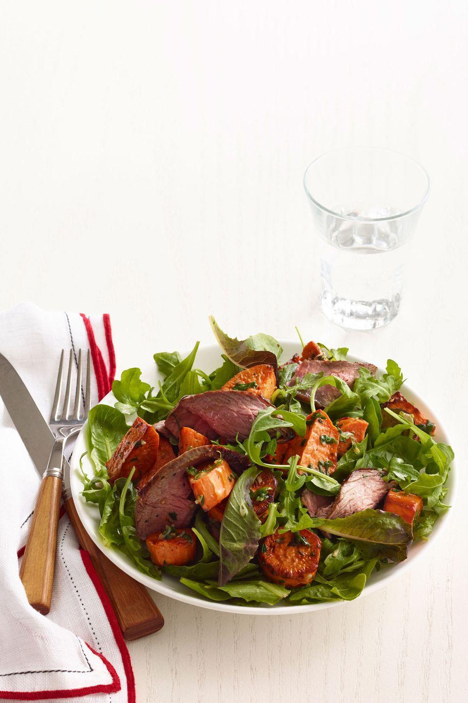 """<p>To keep the portion size in check, this recipe calls for 3 ounces of steak per person. </p><p><em><a href=""""https://www.goodhousekeeping.com/food-recipes/a15484/arugula-sweet-potato-spiced-steak-salad-recipe-wdy0214/"""" rel=""""nofollow noopener"""" target=""""_blank"""" data-ylk=""""slk:Get the recipe for Arugula, Sweet Potato, and Spiced Steak Salad »"""" class=""""link rapid-noclick-resp"""">Get the recipe for Arugula, Sweet Potato, and Spiced Steak Salad »</a></em><br></p>"""