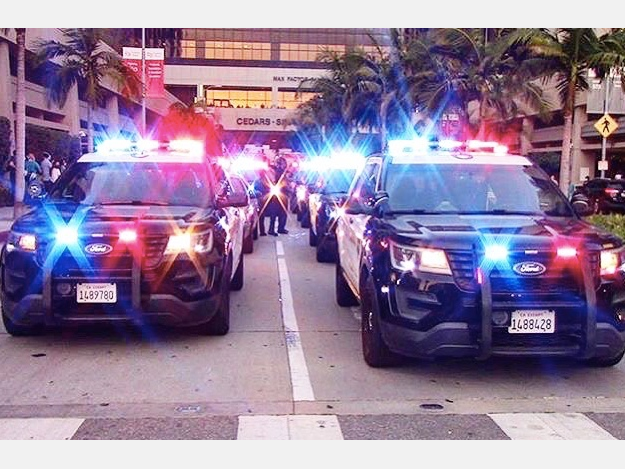 A motorcade of Beverly Hills Police and Fire Department vehicles drove to Cedars-Sinai Medical Center.