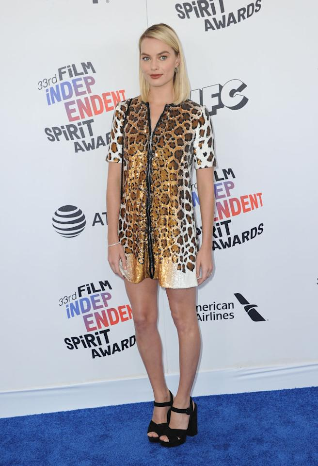<p>The<em> I, Tonya</em> star struck a pose in a leopard-print minidress and black strappy sandals. She kept her beauty minimal, with sleek locks and a pop of burgundy on her lips. (Photo: Getty Images) </p>
