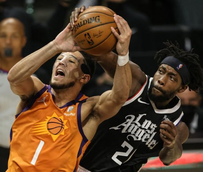 Thursday, June 24, 2021, Los Angeles CA - LA Clippers guard Patrick Beverley (21) fouls Phoenix Suns guard Devin Booker (1) late in the second quarter in Game three of the NBA Western Conference Finals at Staples Center. (Robert Gauthier/Los Angeles Times)