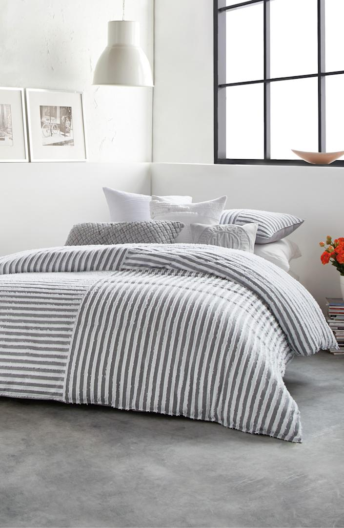 """Spice up your duvet and shams with some playful stripes. This DKNY set also features delicate, feathery details and is machine-washable. $150, Nordstrom. <a href=""""https://www.nordstrom.com/s/dkny-clipped-square-cotton-duvet-cover-sham-set/5613671"""" rel=""""nofollow noopener"""" target=""""_blank"""" data-ylk=""""slk:Get it now!"""" class=""""link rapid-noclick-resp"""">Get it now!</a>"""