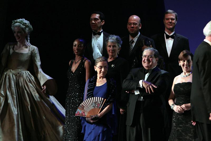 "Justice Ruth Bader Ginsburg, center, and Justice Antonin Scalia, center right, appear on stage on the opening night of the Washington National Opera production of ""Ariadne auf Naxos"" at the John F. Kennedy Center for the Performing Arts in Washington in October 2009. (Photo: Karin Cooper via Getty Images)"