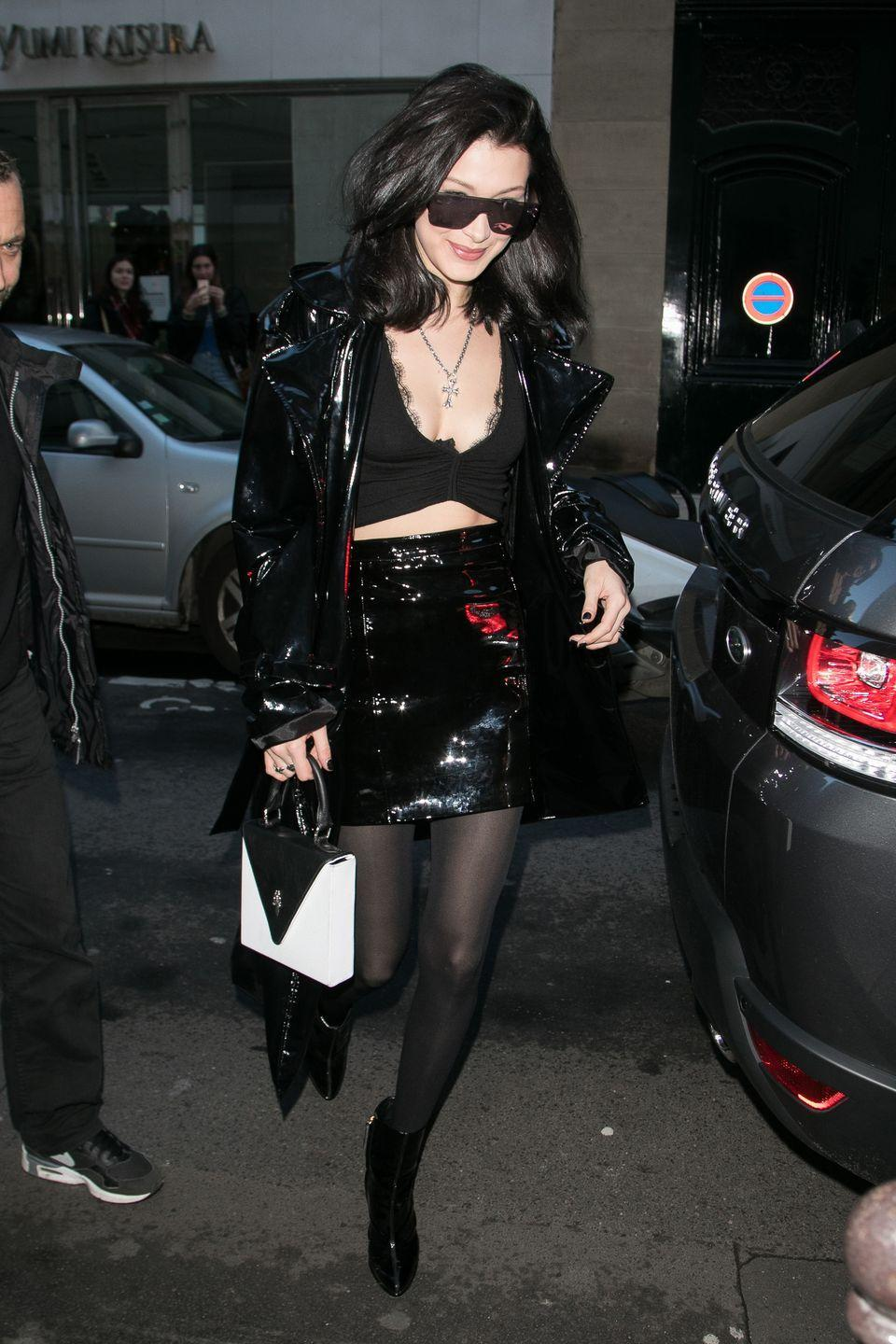 <p>In a cropped lace halter top, black patent jacket and skirt with a Chrome Hearts purse and patent booties by Giuseppe Zanotti while out in Paris.</p>