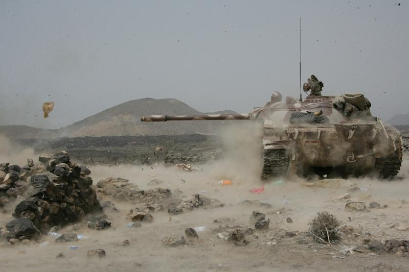 In this photo provided by Yemen's Defense Ministry, an army tank fires at positions of al-Qaida militants near the coastal Yemeni town of Shaqra, Yemen, Wednesday, June 13, 2012. (AP Photo/Yemen Defense Ministry)