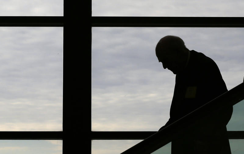 Archbishop Emeritus Francis Hurley, of Anchorage, Ak., is silhouetted as he rides an escalator after a session at the United States Conference of Catholic Bishops' annual fall meeting in Baltimore, Monday, Nov. 11, 2013, their first national meeting since Pope Francis was elected. (AP Photo/Patrick Semansky)
