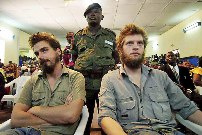 FILE- Norwegian citizens Tjostolv Moland, left and Joshua French listens to the judge read out their sentence in court in Kisangani, Congo, Sept. 8, 2009, on charges of killing their driver Abedi Kasongo, espionage, armed robbery and organised crime. According to government officials and his lawyer Sunday Aug. 18, 2013, Moland has died in prison, aged 32. The cause of death wasn't immediately clear, attorney Hans Marius Graasvold said, while also declaring that British-Norwegian citizen Joshua French, who was imprisoned alongside Moland, is upset but in good health. (AP Photo, FILE) NORWAY OUT