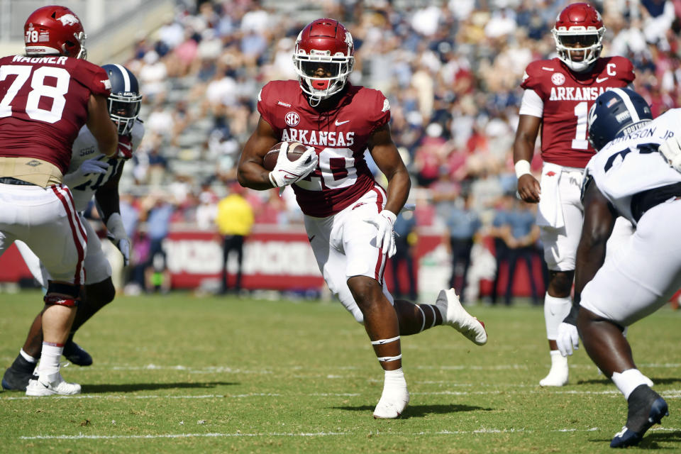 Arkansas running back Dominique Johnson (20) finds a hole in the Georgia Southern defense as he runs for a touchdown during the first half of an NCAA college football game Saturday, Sept. 18, 2021, in Fayetteville, Ark. (AP Photo/Michael Woods)