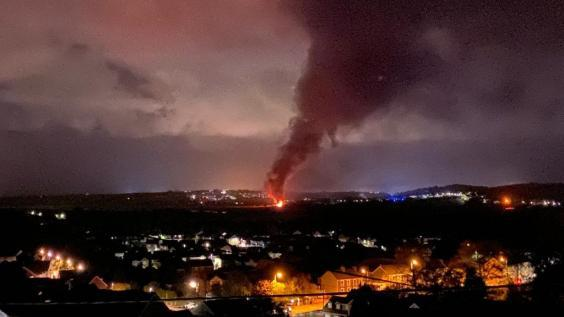 The huge plume of black smoke was visible from several miles away (Adam Tilt)