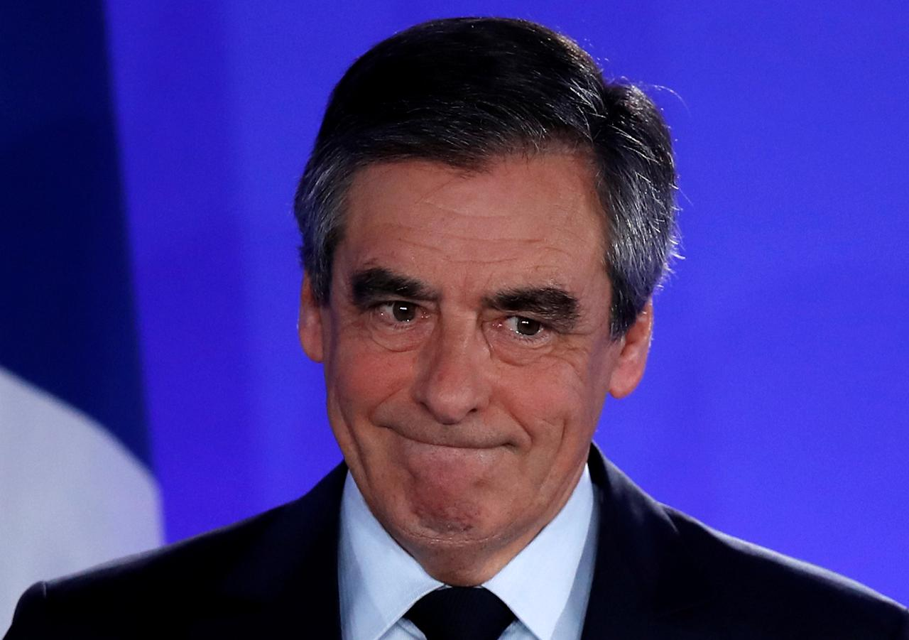 Francois Fillon, member of the Republicans political party and 2017 French presidential election candidate of the French centre-right, reacts as he delivers a speech at his campaign headquarters in Paris after early results in the first round of 2017 French presidential election, France, April 23, 2017. REUTERS/Christian Hartmann          TPX IMAGES OF THE DAY