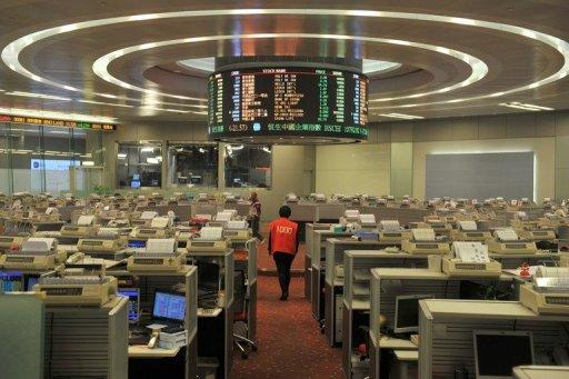 A trader walks the floor of the Hong Kong Stock Exchange