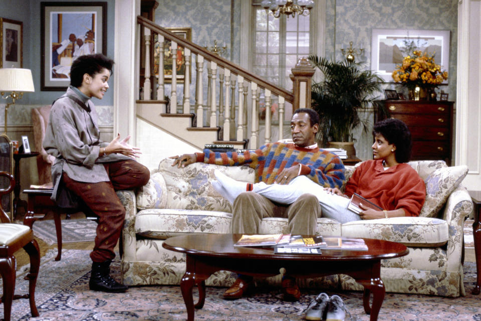 """From <em>The Cosby Show</em>: Lisa Bonet as Denise Huxtable Kendall, Bill Cosby as Dr. Heathcliff """"Cliff"""" Huxtable, and Phylicia Rashad as Clair Hanks Huxtable. (Photo: Getty Images)"""