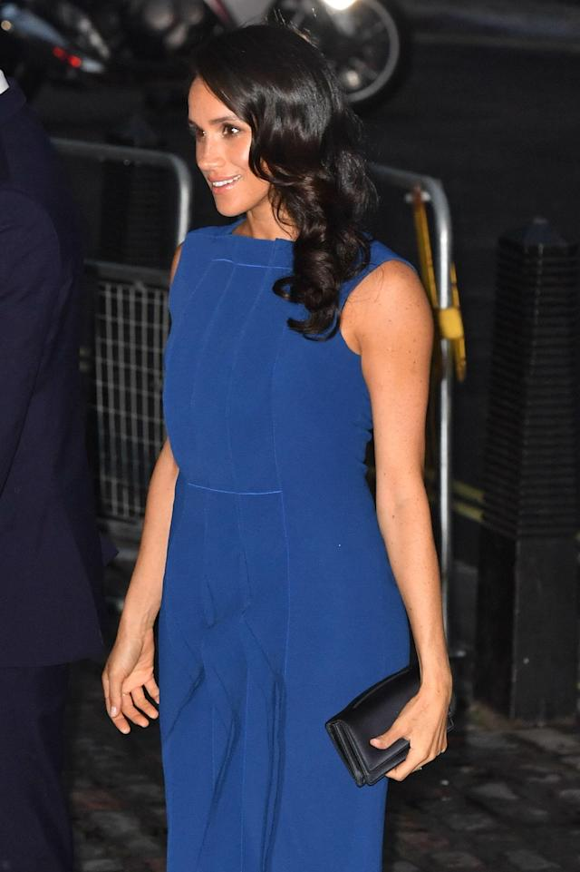 The Duchess of Sussex ditched her go-to messy bun in favour of seriously shiny curls at the charity concert [Photo: PA]