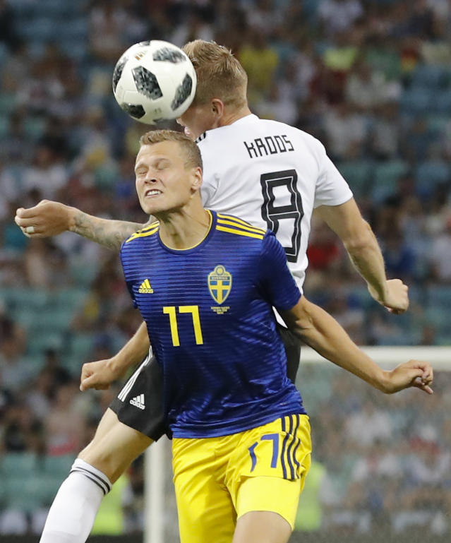 Sweden's John Guidetti, left, and Germany's Toni Kroos jump for the ball during the group F match between Germany and Sweden at the 2018 soccer World Cup in the Fisht Stadium in Sochi, Russia, Saturday, June 23, 2018. (AP Photo/Frank Augstein)