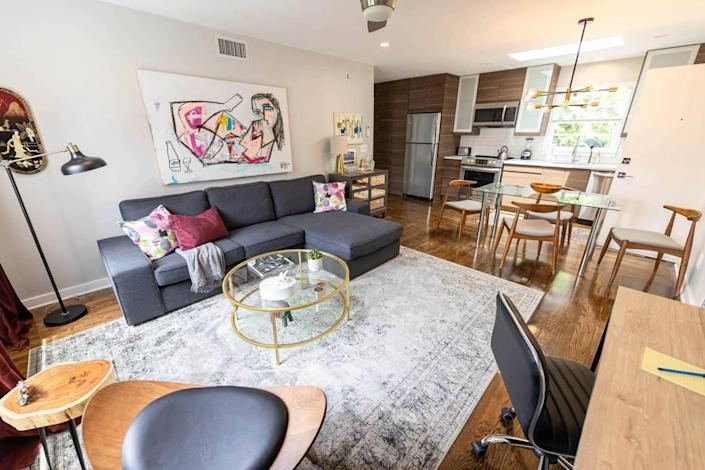 Each living room at The Home Collection's 510 Queens Road building has a painting by Nico Amortegui hanging over the couch.