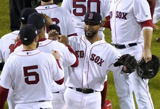 Boston Red Sox infielder Eduardo Nunez (center) celebrates a World Series Game 1 win. Nunez delivered a three-run home run during the seventh inning. (AP)