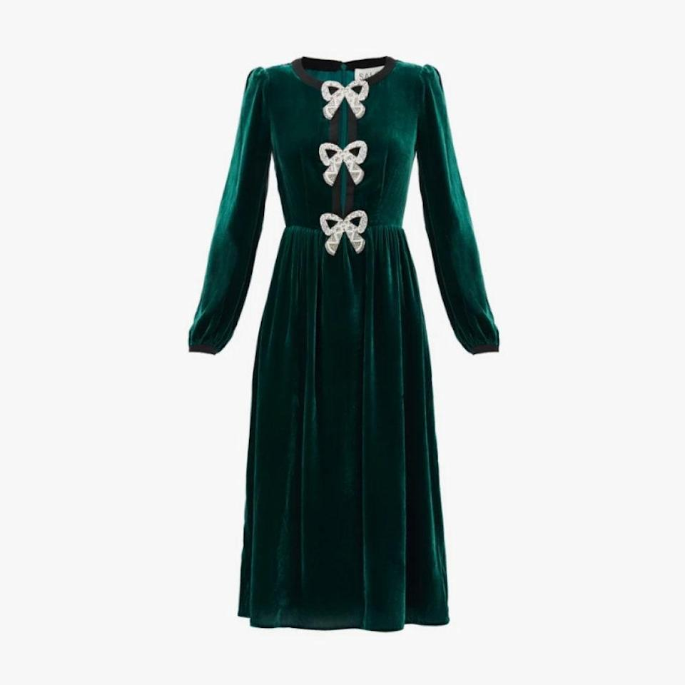 """$795, MATCHESFASHION.COM. <a href=""""https://www.matchesfashion.com/us/products/Saloni-Camille-crystal-bow-velvet-midi-dress-1395878"""" rel=""""nofollow noopener"""" target=""""_blank"""" data-ylk=""""slk:Get it now!"""" class=""""link rapid-noclick-resp"""">Get it now!</a>"""