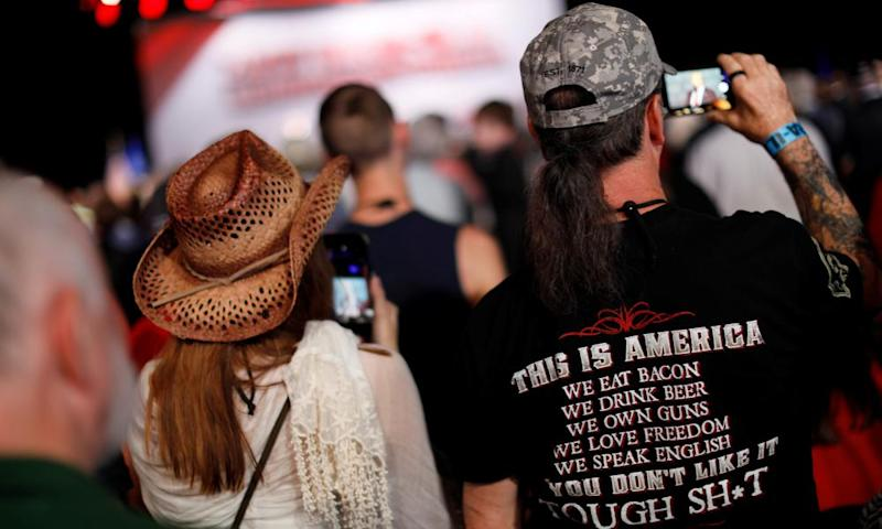Supporters listen to Donald Trump deliver remarks at the NRA Leadership Forum in Atlanta.