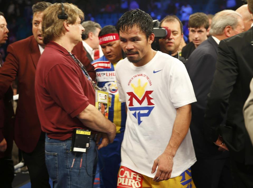 Manny Pacquiao of the Philippines leaves the ring after losing to Floyd Mayweather, Jr. of the U.S. in their welterweight WBO, WBC and WBA (Super) title fight in Las Vegas, Nevada, May 2, 2015. REUTERS/Steve Marcus
