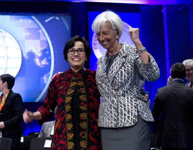 CORRECTS THAT LAGARDE IS ON THE RIGHT, NOT LEFT - International Monetary Fund (IMF) Managing Director Christine Lagarde, right, stands with Development Committee Chair Indonesia Finance Minister Sri Mulyani Indrawati, before the Development Committee plenary, at World Bank/IMF Spring Meetings at IMF headquarters in Washington, Saturday, April 22, 2017. ( AP Photo/Jose Luis Magana)