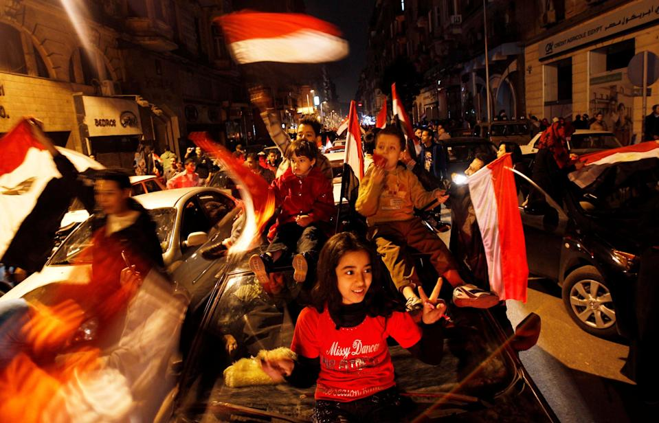 <p>Egyptians celebrate after the announcement of President Hosni Mubarak's resignation in February 2011</p> (REUTERS)