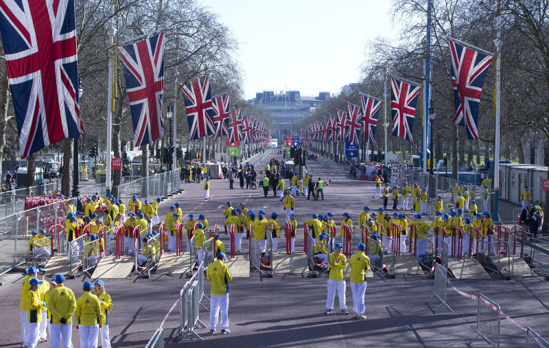 Volunteers in bright yellow get ready prior to the London Marathon in the Mall in London, Sunday, April 21, 2013. Security has been stepped up in London following the recent bombs at the Boston Marathon. The London Marathon started as planned on a glorious sunny morning Sunday despite concerns raised by the bomb attacks on the Boston Marathon six days ago. (AP Photo/Alastair Grant)