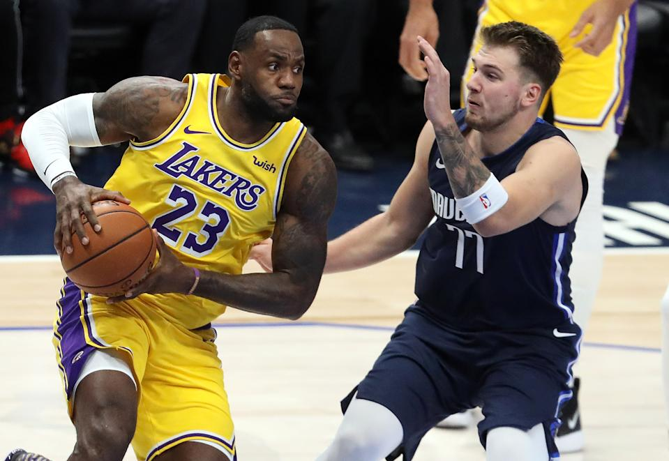 How close is Luka Doncic to taking over as the face of the NBA from LeBron James? (Ronald Martinez/Getty Images)