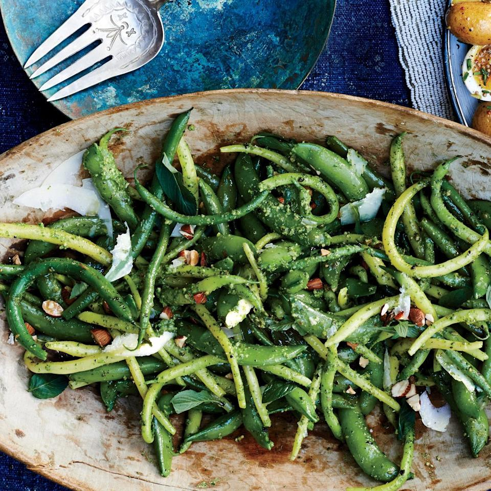 "Come for the garden-fresh snap peas and green beans, stay for the flavor-packed almond-arugula pesto—which is so good you might find yourself putting it on <a href=""https://www.epicurious.com/recipes-menus/go-eat-a-sandwich-gallery?mbid=synd_yahoo_rss"" rel=""nofollow noopener"" target=""_blank"" data-ylk=""slk:sandwiches"" class=""link rapid-noclick-resp"">sandwiches</a>, eggs, pasta, and beyond. <a href=""https://www.epicurious.com/recipes/food/views/snap-peas-and-green-beans-with-arugula-mint-pesto-56389653?mbid=synd_yahoo_rss"" rel=""nofollow noopener"" target=""_blank"" data-ylk=""slk:See recipe."" class=""link rapid-noclick-resp"">See recipe.</a>"