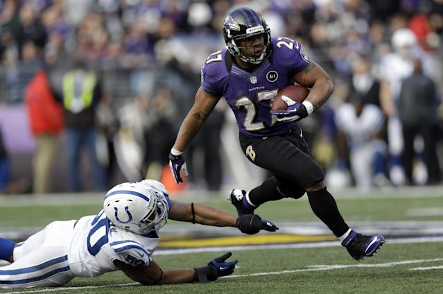 Baltimore Ravens running back Ray Rice (27) runs with the ball and gets away from Indianapolis Colts inside linebacker Jerrell Freeman (50), for a 47 yard gain, during the first half of an NFL wild card playoff football game Sunday, Jan. 6, 2013, in Baltimore. (AP Photo/Patrick Semansky)